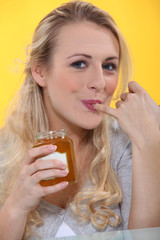 Woman tasting honey