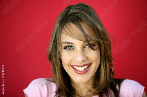 Happy brunette on red background
