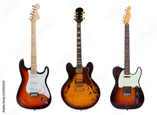 Group of three Electric guitars on white background - 39450439