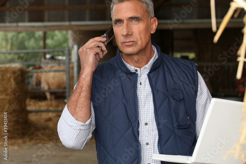 farmer with mobile phone and laptop