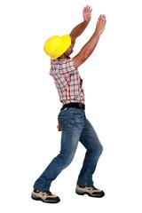 Tradesman lifting an invisible object
