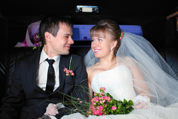 Just married couple in limousine