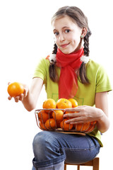 Teenage girl offering a tangerine