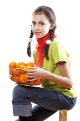 Teenage girl holding a bowl of tangerines