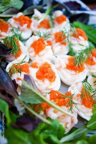 Stuffed eggs with caviar and prawns