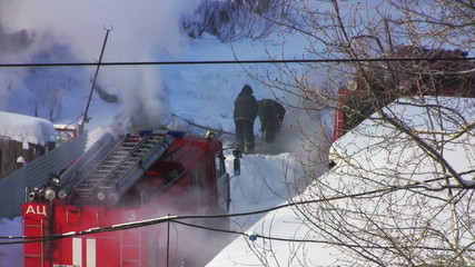 Firefighters extinguish a fire in the pit