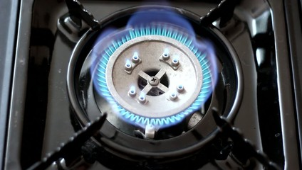 Automatic gas burner with a blue flame.