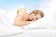 Leinwandbild Motiv Beautiful girl lying on a bed