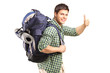 Portrait of a man with backpack giving thumb up