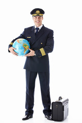 The pilot of a globe and suitcase