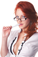 beautiful redhair businesswoman portrait bite a pen isolated on