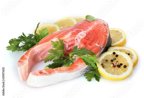 Red fish with lemon, parsley and pepper isolated on white.