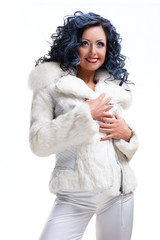 Beautiful brunette in white fur coat