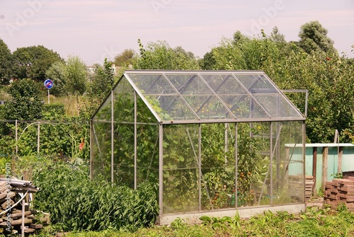 A glass house in a kitchen garden