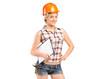 Female mechanic holding a blank clipboard