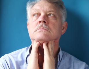 businessman feeling painful lymph glands