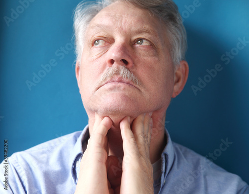 businessman feeling painful lymph glands