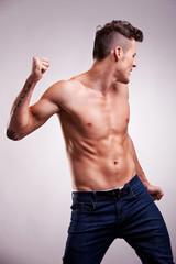 young flexed muscular dancer