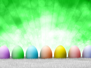 Happy Easter - colored eggs on green background