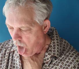 ill senior man coughing
