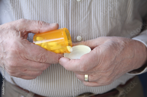 older man gets ready to take a pill