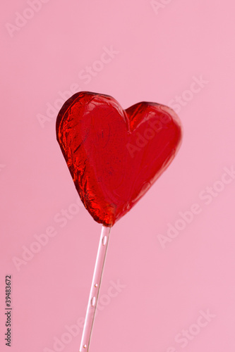 Heart-shaped Lollipop isolated on pink background