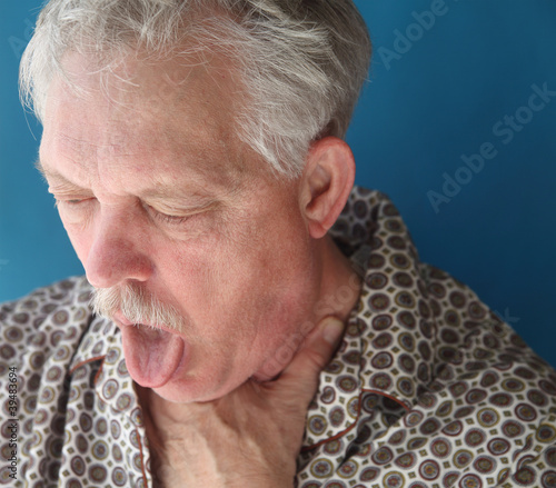 ill senior man coughing