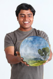Person holding glowing ball containing ecosystem poster
