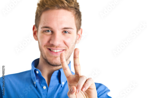 Young man showing victory symbol