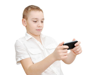Boy is playing racing game on smartphone