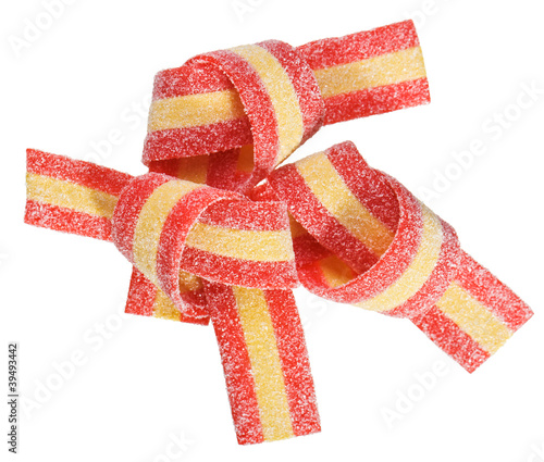 Red and yellow gummy candy (licorice) band, isolated on white cl