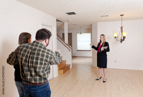 Realtor shows empty home to prospective buyers