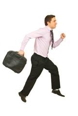 Happy businessman running to work