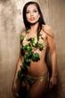 Beautiful woman in bikini with tropical leaves
