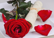 Romantic place setting with red rose and card to label