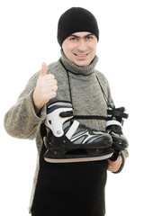 Men with skates gesture shows okay on white background.