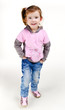 Portrait of happy smiling little girl in jeans