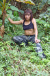 Asian woman in jungle..