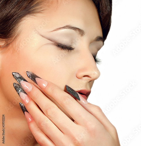 Beautiful girl with makeup and nails