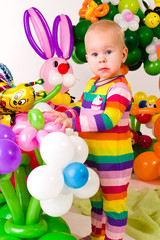 Cute baby in balloon forest
