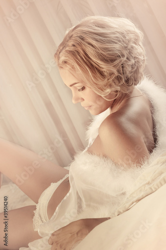 Young sexy beautiful woman on a bed
