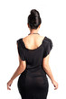 Elegant woman in black dress, back view.