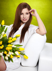 Portrait of a girl with white and yellow tulips