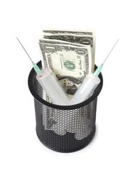 Money and syringe in basket
