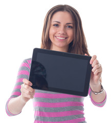 Happy brunette woman holding in hand a tablet touch pad computer