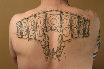 speakers tattooed on the back