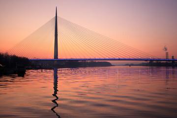 cable bridge Ada in sunset