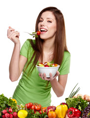 Young smiling woman with fruits and vegetables. Over white backg
