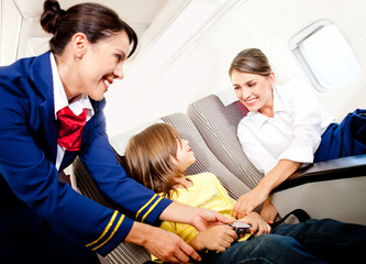 Air hostess helping a kid