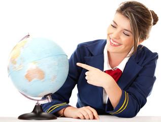 Air hostess pointing at the globe